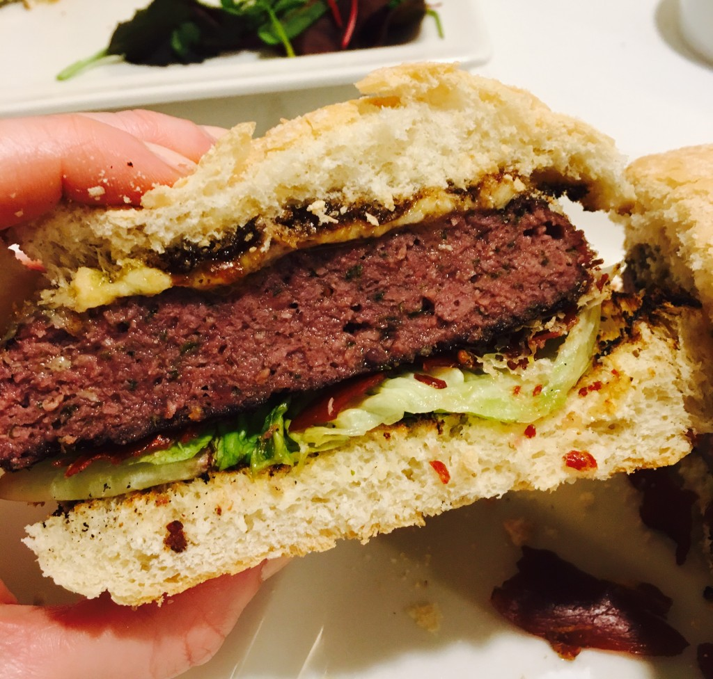 Image shows Gourmet Burger cut in half - Hawthorns Newcastle review by Scran on the Tyne