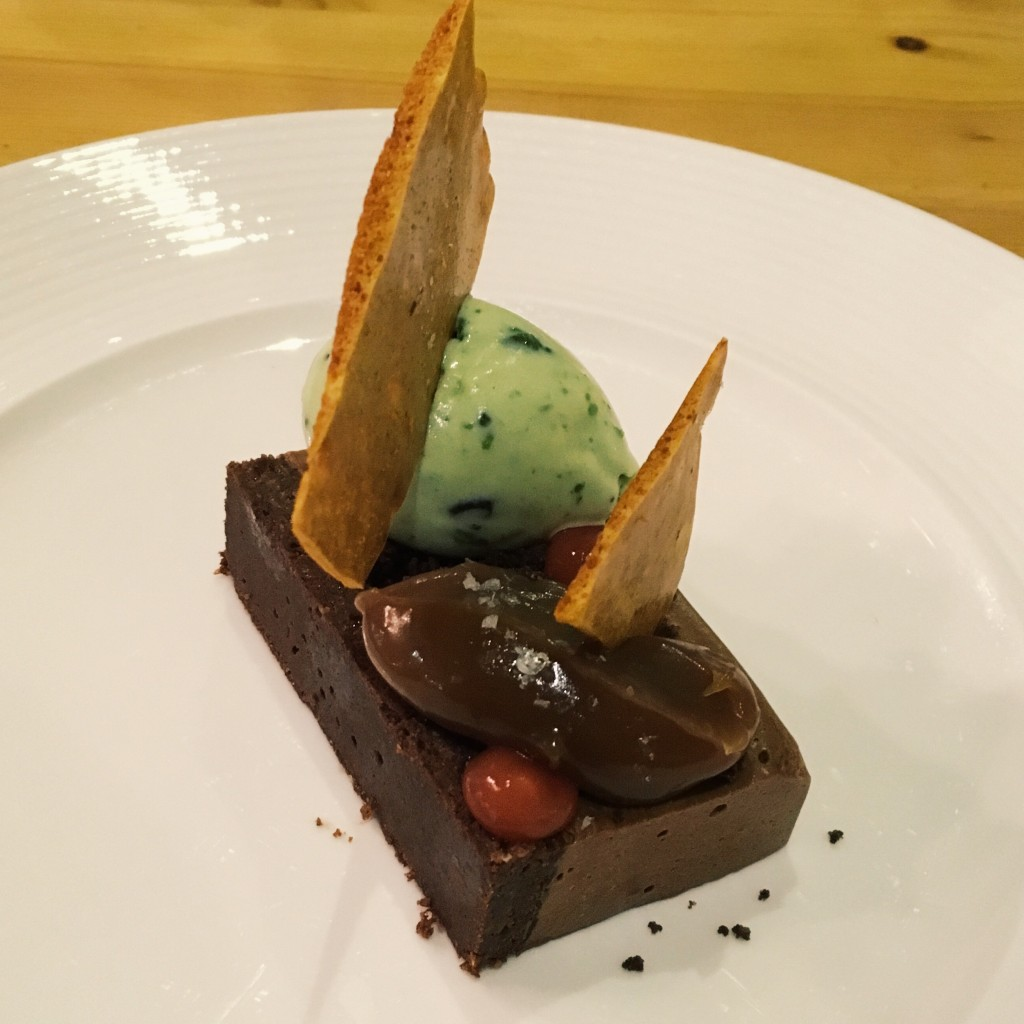 Image shows chocolate pave dessert at Artisan