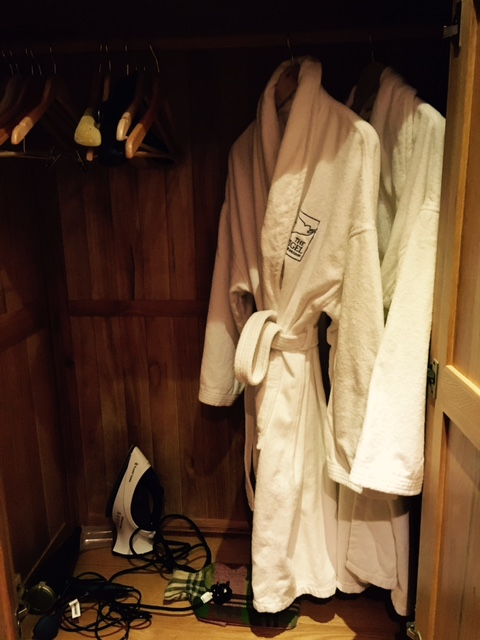 Image shows cupboard packed with hotel room essentials at The angel inn, Corbridge