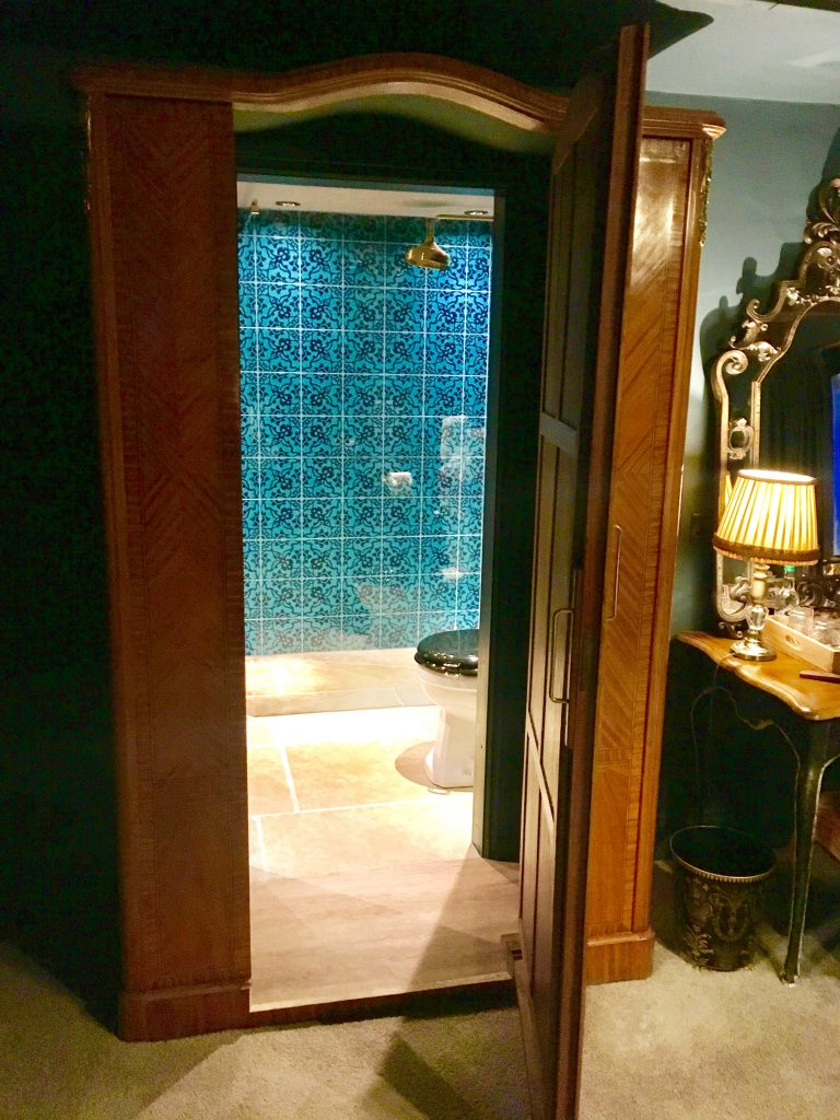 The bathroom through the wardrobe at Le Petit Chateau
